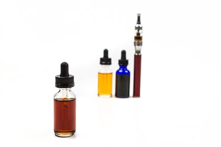 glycol: Flavored vape juice and ecigarette with shallow depth of field and objects out of focus isolated on white background