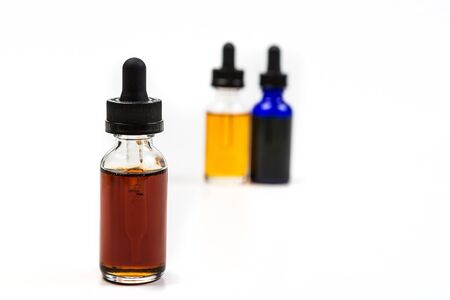Flavored vape juice with shallow depth of field and objects out of focus isolated on white background
