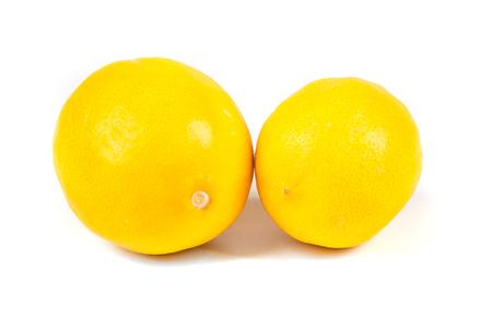 acidic: Two meyer lemons isolated on white background Stock Photo