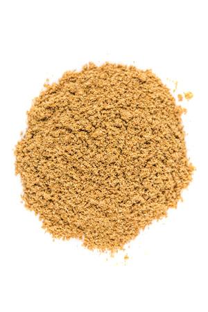 enhancer: Pile of ground coriander isolated on white background