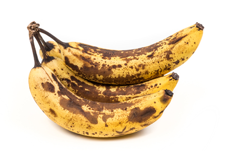 Bunch of overripe bananas isolated on white background