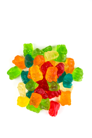 cavities: Green yellow red blue gummy bears isolated on a white background Stock Photo
