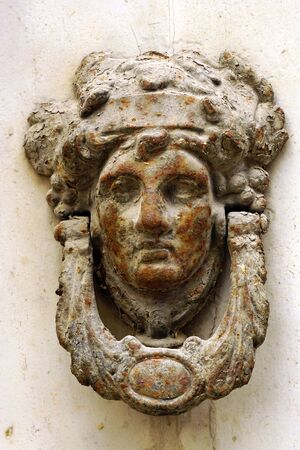 August 14th 2018, Malta: historic door knocker - rusty human head