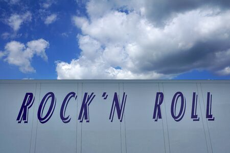 Lettering Rockn Roll with dramatic sky as background