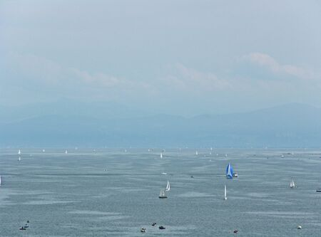 Germany: Lake Constance with ships, sailors and mountains in the background Stok Fotoğraf