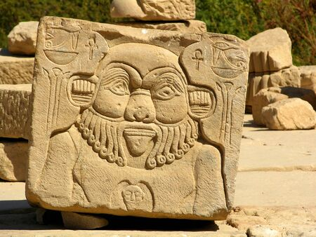 Relief of the ancient Egyptian god Bies Bes carved in stone - Egypt