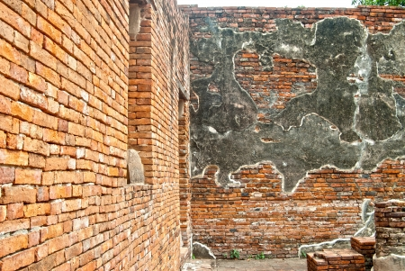 ancient pass: wall of old temple in Ayutthaya, Thailand Stock Photo