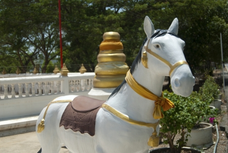 bedeck: white horse molded in front of buddhism temple Stock Photo