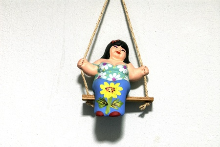 bedeck: woman molded on swing, Thailand