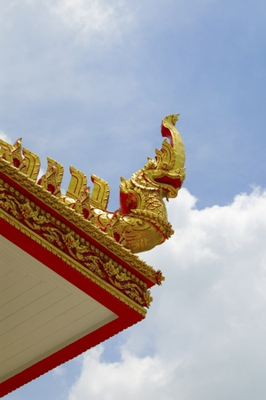snakes and ladders: King nakas on top of roof Stock Photo