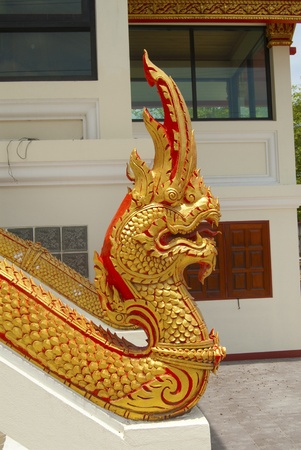snakes and ladders: King nakas molded in Thai temple