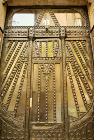 budapest: Geometric design in wrought iron on the door of an Art Deco apartment house in Budapest  Stock Photo