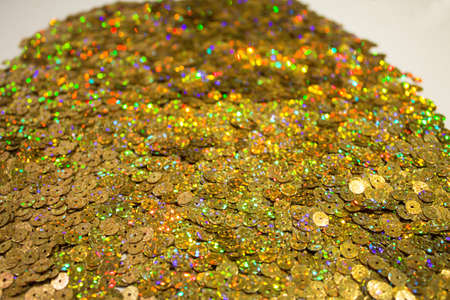 Sequin background glitter surfactant.Fabric sequins in bright colors. Fashion fabric glitter. Abstract background with gold sequins color on the fabric.Decorative accessories for sewing and embroidery Banque d'images