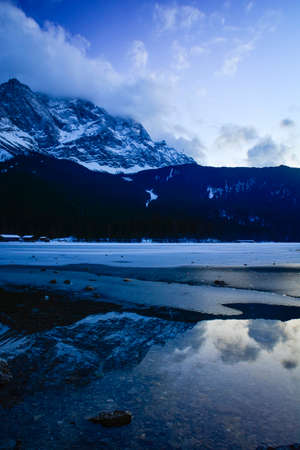 Storm clouds move in over the Zugspitze and the frozen Eibsee, Garmisch-Partenkirchen, Germany  photo