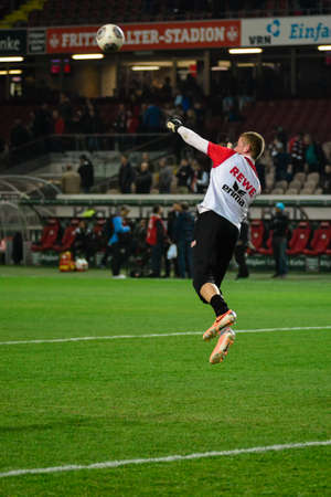 Goalkeeper TIMO HORN (1) punches the ball during team warmups before the match. The 1FC Kaiserslautern hosted the 1FC Koln at Fritz-Walter-Stadion in Kaiserslautern.