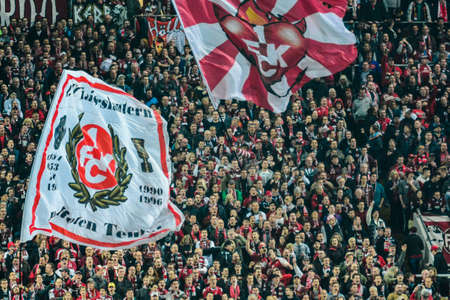 hosted: 1FC Kaiserslautern fans show their excitement before the start of the match. The 1FC Kaiserslautern hosted the 1FC Koln at Fritz-Walter-Stadion in Kaiserslautern.  Editorial