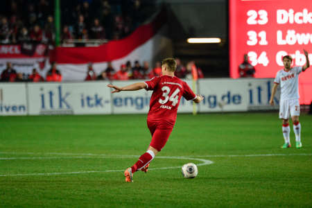 Defender WILLI ORBAN (34) moves the ball downfield toward Midfielder DANIEL HALFAR (22). The 1FC Kaiserslautern hosted the 1FC Koln at Fritz-Walter-Stadion in Kaiserslautern.  Редакционное