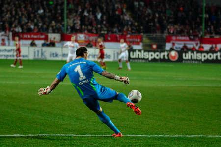 Goalkeeper TOBIAS SIPPEL (1) kicks the ball downfield. The 1FC Kaiserslautern hosted the 1FC Koln at Fritz-Walter-Stadion in Kaiserslautern.  Editorial