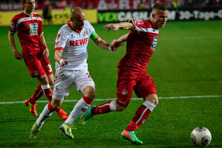 Midfielder ALEXANDER RING (6) and Defender MISO BRECKO (2) fight for the ball. The 1FC Kaiserslautern hosted the 1FC Koln at Fritz-Walter-Stadion in Kaiserslautern.