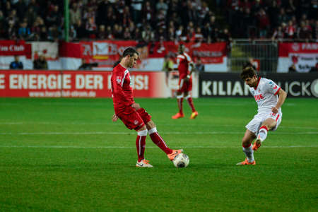 Defender MARC TORREJON (15) evades Forward PATRICK HELMES (16). The 1FC Kaiserslautern hosted the 1FC Koln at Fritz-Walter-Stadion in Kaiserslautern.