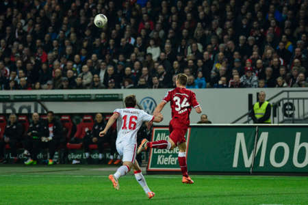 Defender WILLI ORBAN (34) beats Forward PATRICK HELMES (16) to the ball and headers it back downfield. The 1FC Kaiserslautern hosted the 1FC Koln at Fritz-Walter-Stadion in Kaiserslautern.