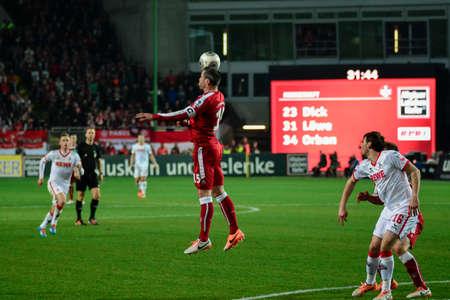 hosted: Defender MARC TORREJON (15) headers the ball. The 1FC Kaiserslautern hosted the 1FC Koln at Fritz-Walter-Stadion in Kaiserslautern.  Editorial
