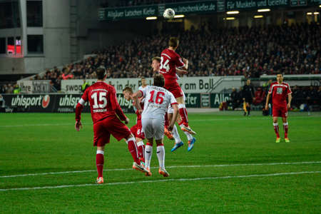 Defender WILLI ORBAN (34) out leaps everyone to header the ball. The 1FC Kaiserslautern hosted the 1FC Koln at Fritz-Walter-Stadion in Kaiserslautern.  Редакционное
