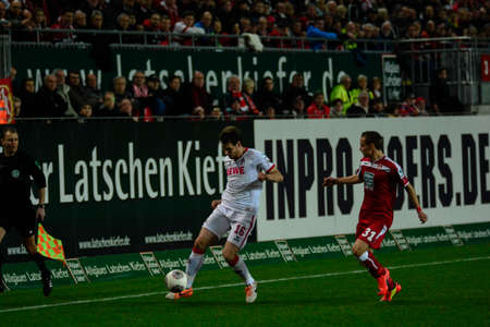 Forward PATRICK HELMES (16) moves the ball past Defender CHRIS LOWE (31). The 1FC Kaiserslautern hosted the 1FC Koln at Fritz-Walter-Stadion in Kaiserslautern.