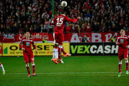 Defender MARC TORREJON (15) and Forward ANTHONY UJAH (9) jump for the ball. The 1FC Kaiserslautern hosted the 1FC Koln at Fritz-Walter-Stadion in Kaiserslautern.  Редакционное