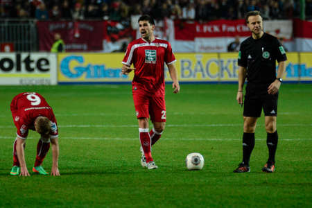 Defender FLORIAN DICK (23) has a discussion with a 1FC Koln player as Midfielder ALEXANDER RING (6) gets up after being fouled. The 1FC Kaiserslautern hosted the 1FC Koln at Fritz-Walter-Stadion in Kaiserslautern.