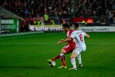 billygoat: Forward KARIM MATMOUR (16) moving the ball past Midfielder ADAM MATUSCHYK (8). The 1FC Kaiserslautern hosted the 1FC Koln at Fritz-Walter-Stadion in Kaiserslautern.  Editorial