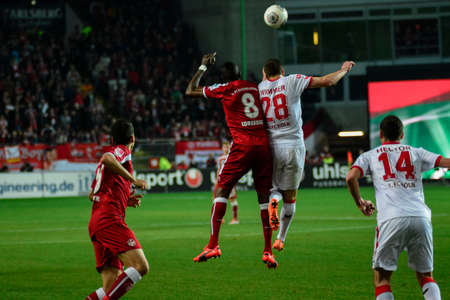 Forward MOHAMADOU IDRISSOU (8) and Defender KEVIN WIMMER (28) leap after the ball. The 1FC Kaiserslautern hosted the 1FC Koln at Fritz-Walter-Stadion in Kaiserslautern.