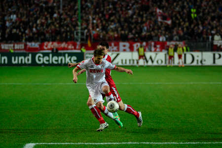 Midfielder DANIEL HALFAR (22) drives the ball past Defender FLORIAN DICK (23). The 1FC Kaiserslautern hosted the 1FC Koln at Fritz-Walter-Stadion in Kaiserslautern.