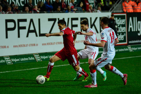 Forward KARIM MATMOUR (16) gets past Midfielder DANIEL HALFAR (22) and Defender JONAS HECTOR (14). The 1FC Kaiserslautern hosted the 1FC Koln at Fritz-Walter-Stadion in Kaiserslautern.