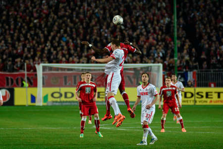 Forward MOHAMADOU IDRISSOU (8) out jumps Defender KEVIN WIMMER (28) to header the ball. The 1FC Kaiserslautern hosted the 1FC Koln at Fritz-Walter-Stadion in Kaiserslautern.  Редакционное