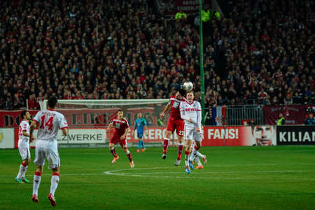 Defender FLORIAN DICK (23) and Midfielder YANNICK GERHARDT (31) header the ball. The 1FC Kaiserslautern hosted the 1FC Koln at Fritz-Walter-Stadion in Kaiserslautern.