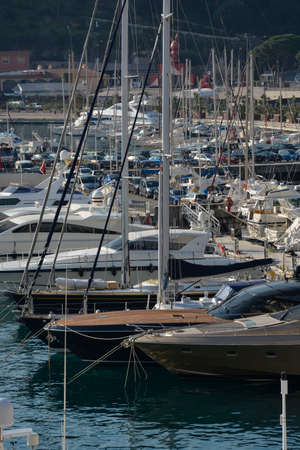 MONTE CARLO, MONACO - MARCH 11: Boats of every shape and size are packed into the crowded harbor. The popularity of the principality as a travel destination has created a very crowded environment, whether on land or water, Monte Carlo, Monaco on March 11  Stock Photo - 27521494
