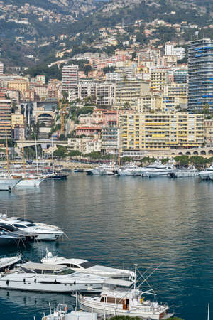popularity: MONTE CARLO, MONACO - MARCH 11: Boats of every shape and size are packed into the crowded harbor. The popularity of the principality as a travel destination has created a very crowded environment, whether on land or water,  Monte Carlo, Monaco on March 11