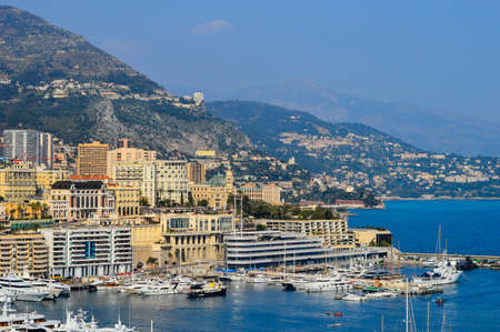 popularity: MONTE CARLO, MONACO - MARCH 12: Boats of every shape and size are packed into the crowded harbor. The popularity of the principality as a travel destination has created a very crowded environment, whether on land or water,  Monte Carlo, Monaco on March 12 Editorial