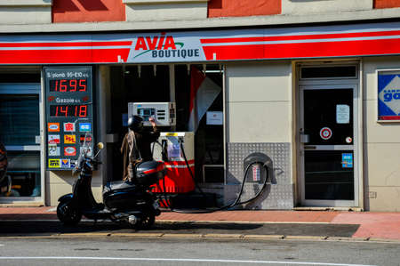 cramped space: MONTE CARLO, MONACO - MARCH 12: Cramped spaces in the principality means all available space must be used, here a gas station with a single pump is literally located on the side walk, Monte Carlo, Monaco on March 12 2014.  Editorial
