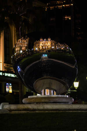 MONTE CARLO, MONACO - MARCH 12: The Monte Carlo Casino reflected in the Sky Mirror sculpture at night, Monte Carlo, Monaco on March 12 2014.  Sajtókép