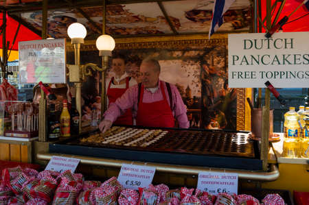 dutch girl: ALKMAAR, NETHERLANDS - APRIL 11: The centuries old cheese market in Alkmaar is by far the towns biggest tourist attraction. Every Friday morning from April through September at 10:00 the Waagplein (weighing square) comes to life, full of vendors selling t
