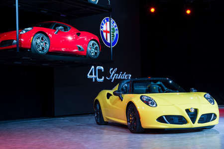 alfa: Detroit, MI, USA - January 12, 2015: Alfa Romeo 4C Spider on display during the 2015 Detroit International Auto Show at the COBO Center in downtown Detroit.