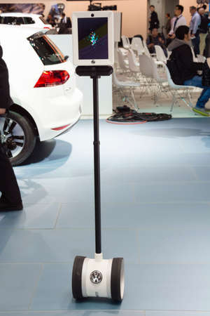 international sales: Detroit, MI, USA - January 12, 2015: Volkswagens autonomous sales guide on display during the 2015 Detroit International Auto Show at the COBO Center in downtown Detroit.