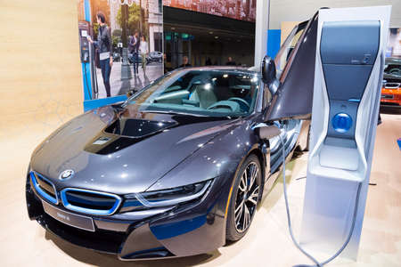 Detroit, MI, USA - January 12, 2015: BMW i8 electric supercar and charging station on display during the 2015 Detroit International Auto Show at the COBO Center in downtown Detroit.