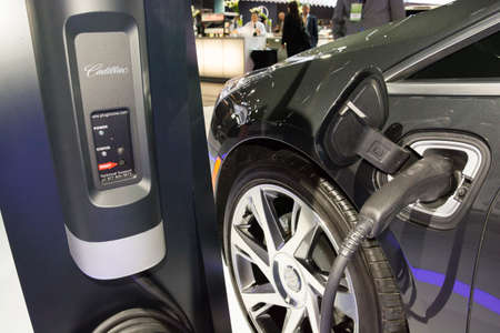 Detroit, MI, USA - January 12, 2015: Cadillac ELR charging station on display during the 2015 Detroit International Auto Show at the COBO Center in downtown Detroit.