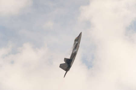 md: CAMP SPRINGS, MD, USA - SEPTEMBER 19, 2015: The F-22 performs during the 2015 Joint Base Andrews Air Show held at Joint Base Andrews in Camp Springs Maryland.