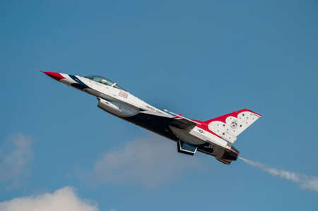 usaf: CAMP SPRINGS, MD, USA - SEPTEMBER 19, 2015: The USAF Thunderbirds perform during the 2015 Joint Base Andrews Air Show held at Joint Base Andrews in Camp Springs Maryland. Editorial