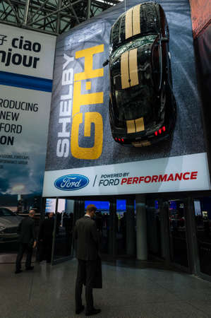 hertz: New York, USA - March 23, 2016: Ford Shelby GTH hangs over the entry to the New York International Auto Show at the Jacob Javits Center.