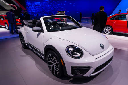 jacob: New York, USA - March 23, 2016: Volkswagen Beetle convertible on display during the New York International Auto Show at the Jacob Javits Center.